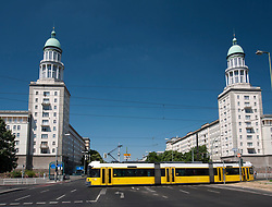 View of famous landmark towers at Frankfurter Tor and tram on Karl Marx Allee in former east Berlin in Germany