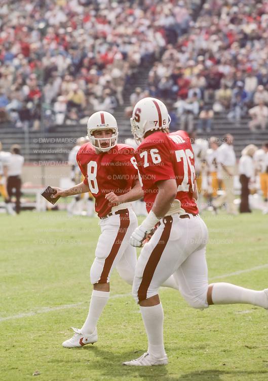 COLLEGE FOOTBALL:  Stanford vs Arizona State on October 24, 1981 at Stanford Stadium in Palo Alto, California.  Mark Harmon #8, Ken Cunz #76.  Photograph by David Madison ( www.davidmadison.com ).
