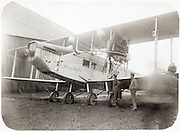 vintage airplane with people standing by it 1920s