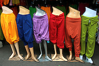 Colorful Pants Display at Chatuchak Market - sometimes called the Weekend Market is the largest market in Thailand, and one of the largest of the world.  It covers over 35 acres and contains more than 5,000 stalls not counting wandering vendors and street entertainers. On a good day the market receives between 200,000 and 300,000 visitors. The market offers a wide variety of products including household items, clothing, Thai handicrafts, religious artifacts, collectibles, foods and even live animals.