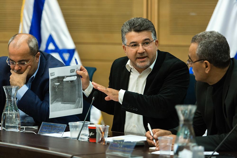 Arab Israeli Knesset Member Yousef Jabareen (C), at the Knesset, Israel's parliament in Jerusalem, on April 13, 2016.