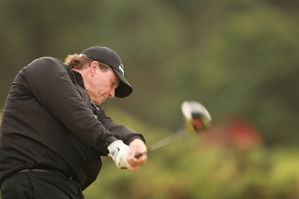 CARNOUSTIE, SCOTLAND - JULY 19:  Phil Mickelson follows through on a tee shot during the first round of the 136th Open Championship in Carnoustie, Scotland at Carnoustie Golf Links on Thursday, July 19, 2007. (Photo by Darren Carroll/Getty Images) *** LOCAL CAPTION *** Phil Mickelson