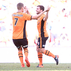 BRISBANE, AUSTRALIA - JANUARY 7: Tommy Oar of the Roar celebrates scoring a goal with Thomas Kristensen of the Roar during the round 14 Hyundai A-League match between the Brisbane Roar and Newcastle Jets at Suncorp Stadium on January 7, 2017 in Brisbane, Australia. (Photo by Patrick Kearney/Brisbane Roar)