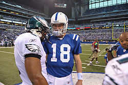 INDIANAPOLIS, IN - JANUARY 20: Quarterback Donovan McNabb #5 of the Philadelphia Eagles talks with quarterback Peyton Manning #18 of the Indianapolis Colts on August 20, 2009 at Lucas Oil Stadium in Indianapolis, Indiana. The Colts won 23-15. (Photo by Drew Hallowell)  *** Local Caption *** Peyton Manning;Donovan McNabb