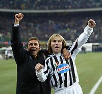 Milano 12/2/2004 Coppa Italia - Italy Cup - Semifinale <br />Inter - Juventus 2-2 (6-7 after penalties) <br />Pavel Nedved and Antonio Conte (Juventus) festeggiano la vittoria finale<br />Photo Andrea Staccioli Graffiti
