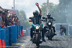 Unknown Industries stunt team performing at the Harley-Davidson display downtown Sturgis on the final Saturday of the annual Black Hills Motorcycle Rally.  SD, USA.  August 13, 2016.  Photography ©2016 Michael Lichter.