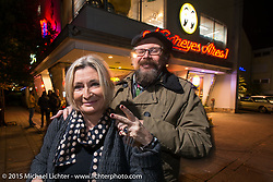 Lowride Magazine's Giuseppe Roncen and Marie-Line Thioulouze outside the Moon Cafe during the Mooneyes Yokohama Hot Rod & Custom Show after-party at Mooneyes headquarters. Yokohama, Japan. December 7, 2015.  Photography ©2015 Michael Lichter.