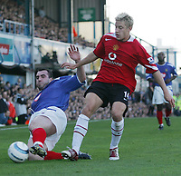 Fotball<br /> Premier League England 2004/2005<br /> Foto: SBI/Digitalsport<br /> NORWAY ONLY<br /> <br /> 30.10.2004<br /> Portsmouth v Manchester United<br /> <br />  Manchester's Alan Smith is tackled by Portsmouth's David Unsworth