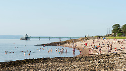 © Licensed to London News Pictures;21/07/2021; Clevedon, UK. People swim at Clevedon seaside on one of the hottest days of the year with a national extreme heat warning. Photo credit: Simon Chapman/LNP.