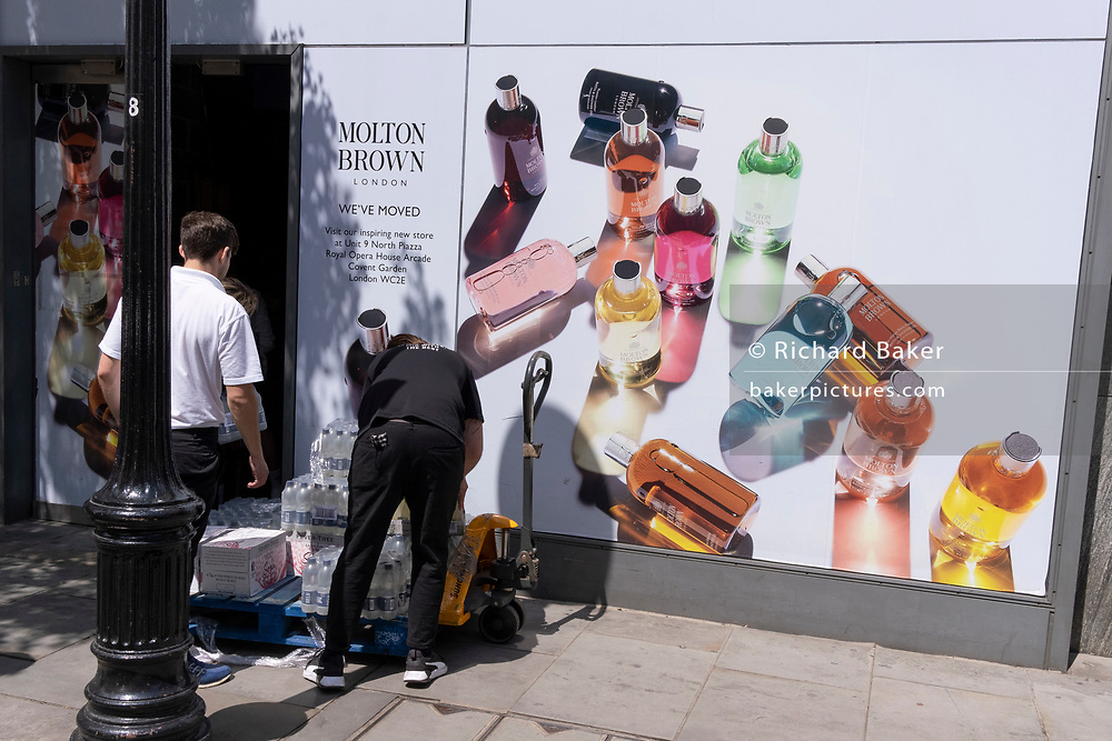 A retail business employee loads recently-delivered supplies near Covent Garden, on 23rd June 2021, in Westminster, London, England.