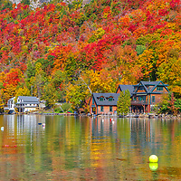 Vermont fall foliage scenery of lakeside houses and boathouses at Lake Willoughby in the North East Kingdom of Vermont.<br /> <br /> Lake Willoughby Vermont Northeast Kingdom fine art photography images are available as museum quality photo, canvas, acrylic, wood or metal prints. Wall art prints may be framed and matted to the individual liking and New England interior design projects decoration needs.<br /> <br /> Good light and happy photo making!<br /> <br /> My best,<br /> <br /> Juergen