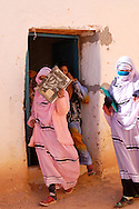 Students get out of the class on December 13, 2003, in the Saharawi refugee camps. Saharawi people have been living at the refugee camps of the Algerian desert named Hamada, or desert of the deserts, for more than 30 years now. Saharawi people have suffered the consecuences of European colonialism and the war against occupation by Moroccan forces. Polisario and Moroccan Army are in conflict since 1975 when Hassan II, Moroccan King in 1975, sent more than 250.000 civilians and soldiers to colonize the Western Sahara when Spain left the country. Since 1991 they are in a peace process without any outcome so far. (Ander Gillenea / Bostok Photo)