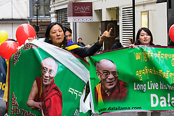"""London, September 21st 2015. Protests by Shugden Buddhists who allege that the Dalai  Lama discriminates against their sect, protest outside the Lyceum Theatre in London as the Dalai Lama attends """"An Afternoon With The Dalai Lama And Friends"""" event as part of his UK visit. Loyalists staged a counter protest welcoming the Buddhist leader to London. PICTURED: A Dalai Lama Loyalist makes an obscene gesture as she passed protesting Shugden Buddhists."""