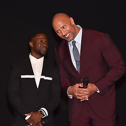 """Dwayne Johnson releases a photo on Instagram with the following caption: """"Kev: You know it\u2019s gotten to the point where I can\u2019t stand the way you even breathe. \nDJ: *smiles I do and you\u2019re still shorter than my cat so f*ck off. \nLove my brother @kevinhart4real. Now one works harder to bring smiles to people faces. Our #JUMANJI press tour has been a special one. \n#Ohana #HardestWorkersInTheRoom \ud83e\udd19\ud83c\udffe @kevinmazur \ud83d\udcf8"""". Photo Credit: Instagram *** No USA Distribution *** For Editorial Use Only *** Not to be Published in Books or Photo Books ***  Please note: Fees charged by the agency are for the agency's services only, and do not, nor are they intended to, convey to the user any ownership of Copyright or License in the material. The agency does not claim any ownership including but not limited to Copyright or License in the attached material. By publishing this material you expressly agree to indemnify and to hold the agency and its directors, shareholders and employees harmless from any loss, claims, damages, demands, expenses (including legal fees), or any causes of action or allegation against the agency arising out of or connected in any way with publication of the material."""