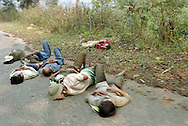 Workers sleeping on a road in the countryside of Dien Bien Phu.