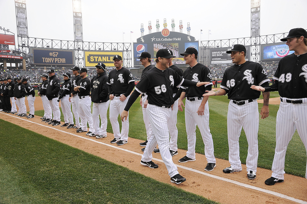 CHICAGO - APRIL 07:  Mark Buehrle #56 of the Chicago White Sox is greeted by teammates during Opening Day ceremonies prior to the game between the Chicago White Sox and Tampa Bay Rays on April 07, 2011 at U.S. Cellular Field in Chicago, Illinois.  The White Sox defeated the Rays 5-1.  (Photo by Ron Vesely)  Subject: Mark Buehrle