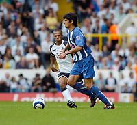 Photo: Leigh Quinnell.<br /> Tottenham Hotspur v Porto. Pre Season Friendly.<br /> 06/08/2005. Tottenham Wayne Routledge keeps an eye on Portos Gonzalez Lucho