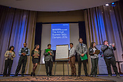 Purchase, NY – 31 October 2014. The Peekskill High School team presenting their case. (Left to right: Diana Barreto, Jovanny Elliott, Ariel Ortiz, Chris Garzon, Oswal Perez, Ricardo Archila, Emigael Aplern, Emmet Warmbrand ) The Business Skills Olympics was founded by the African American Men of Westchester, is sponsored and facilitated by Morgan Stanley, and is open to high school teams in Westchester County.
