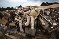 Pile of contents removed from a strip mall in Denham Springs Louisiana after a 1000 year flood.