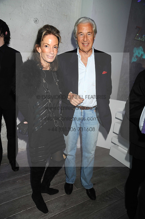MARTIN & ANNE SUMMERS at a party hosted by Kate Sumner at Zadig & Voltaire to celebrate the brand's arrival in London at 182 Westbourne Grove, London W11 on 14th October 2008.