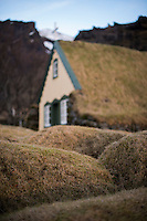 Old graves and Hofskirkja in Öræfi, Southeast Iceland. The church was built in 1884, and was the last turf church built in the old style. It is one of six churches still standing, which are preserved as historical monuments.