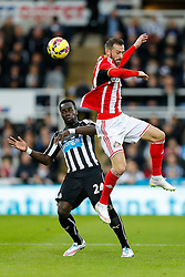 Steven Fletcher of Sunderland is challenged by Cheik Ismael Tiote of Newcastle United - Photo mandatory by-line: Rogan Thomson/JMP - 07966 386802 - 21/12/2014 - SPORT - FOOTBALL - Newcastle upon Tyne, England - St James' Park - Newcastle United v Sunderland - Tyne-Wear derby - Barclays Premier League.