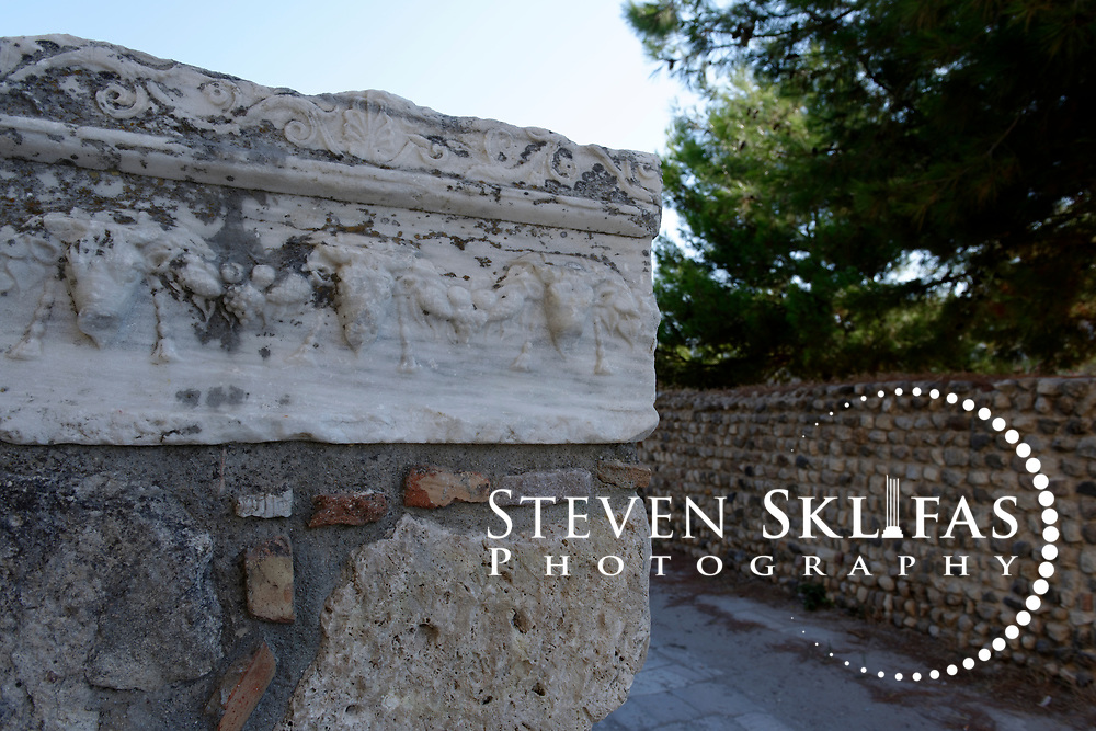 Kos Town.  A large marble block ornately carved from the Hellenistic Roman period in the Western Archaeological Zone. Kos is part of the Dodecanese island group and birthplace of the ancient physician and father of medicine, Hippocrates.