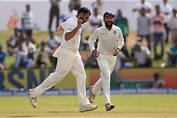 July 27, 2017 - Galle, Sri Lanka - Indian fast bowler Mohammed Shami(L) celebrates after taking a wicket as his team mate Cheteshwar Pujara..joins in during  the 2nd Day's play in the 1st Test match between Sri Lanka and India at the Galle International cricket stadium, Galle, Sri Lanka on Thursday 27 July 2017. (Credit Image: © Tharaka Basnayaka/NurPhoto via ZUMA Press)