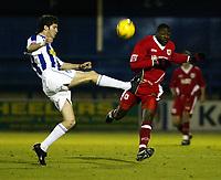 Photo: Chris Ratcliffe.<br />Colchester United v Bristol City. Coca Cola League 1. 17/01/2006.<br />Bas Savage (R) of Bristol City chases down Pat Baldwin of Colchester.