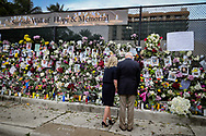 President Joe Biden and First Lady Jill Biden visit the Surfside Wall of Hope & Memorial near the collapsed 12-story oceanfront condominium, Champlain Towers South, in Surfside, Florida on Thursday, July 1, 2021.