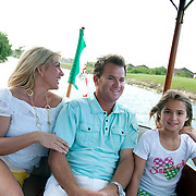 Brian Gay, 2008 champion of the Mayakoba Golf Classic at Riviera Maya-Cancun, a PGA Tour tournament held along the Caribbean in the Riviera Maya, enjoys time with his family on a canal boat including his wife, Kimberly, and daughters Makinley Kathryn 9, and Brantley Olivia, 5.