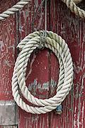 Nautical rope hangs on a weathered shack, New England, USA