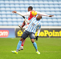Fleetwood Town's Amari'i Bell vies for possession with Coventry City's Marc-Antoine Fortune<br /> <br /> Photographer Andrew Vaughan/CameraSport<br /> <br /> Football - The Football League Sky Bet League One - Coventry City v Fleetwood Town - Saturday 27th February 2016 - Ricoh Stadium - Coventry   <br /> <br /> © CameraSport - 43 Linden Ave. Countesthorpe. Leicester. England. LE8 5PG - Tel: +44 (0) 116 277 4147 - admin@camerasport.com - www.camerasport.com