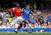 Photo: Ed Godden.<br />Chelsea v Charlton Athletic. The Barclays Premiership. 09/09/2006. Andriy Shevchenko (R) is challenged by Charlton's Souleymane Diawara.