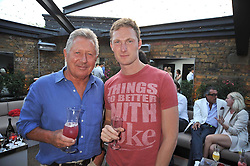 Left to right, RICHARD NORTHCOTT and SAM HOARE at the launch party of the new Embargo 59 nightclub at 533 Kings Road, London on 25th June 2009.