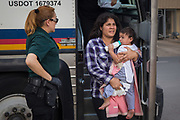 Asylum-seeking migrants are dropped off at a bus station shortly after being released from ICE detention in McAllen, Texas, U.S., June 17, 2018.