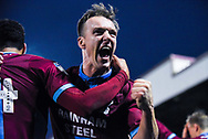 Anthony McMahon of Scunthorpe United (4) celebrates James Perch of Scunthorpe United (14) scoring a goal to make the score 1-0 during the EFL Sky Bet League 1 match between Scunthorpe United and Coventry City at Glanford Park, Scunthorpe, England on 5 January 2019.