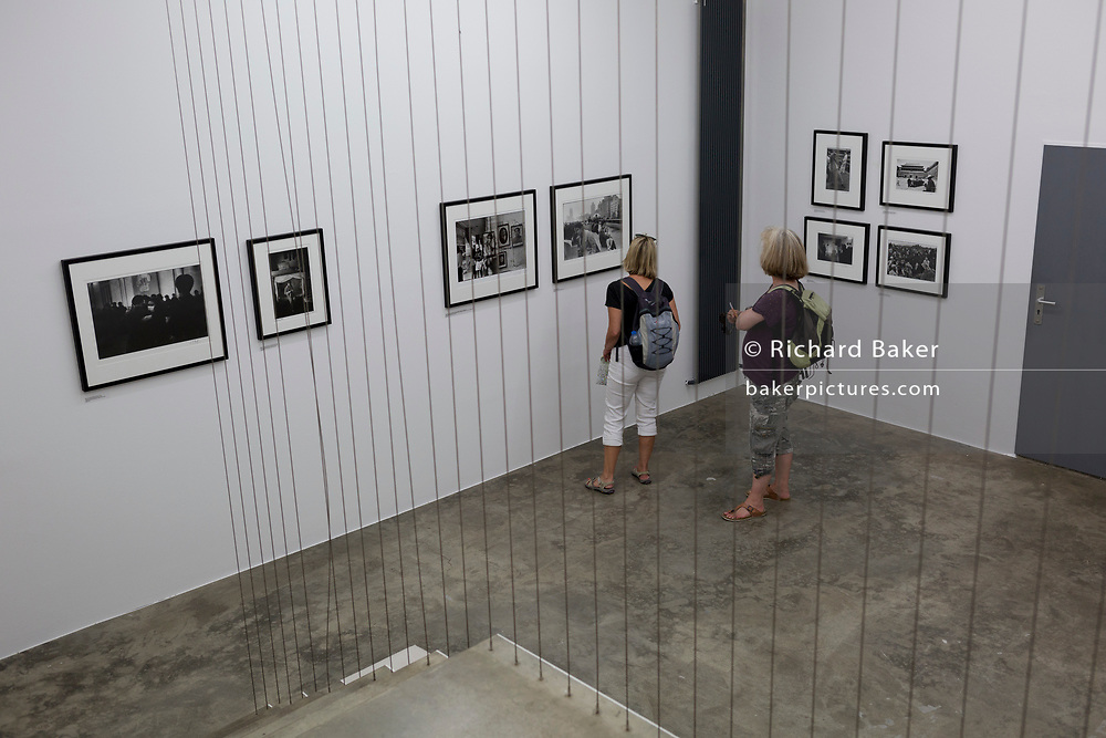Visitors admire Magnum's Marc Riboud photography exhibition at Galerija Fotografija on Levstikov trg in the Slovenian capital, Ljubljana, on 27th June 2018, in Ljubljana, Slovenia.