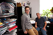 """Thomas Herndon (left) Graduate student at the University of Massachusetts in Amherst and Robert Pollin (right), Co-Director of the Political Economy Research Institute at University of Massachusetts in Amherst, pose for a portrait in the Gordon Hall building in the UMass campus in Amherst, Massachusetts on June 26, 2013. Herndon and Pollin wrote an article that critiques and finds flaws in Reingart's and Rogoff's """"Growth in a Time of Debt"""" article. Editorial Photography for magazines, brochures  and annual reports using a candid approach."""