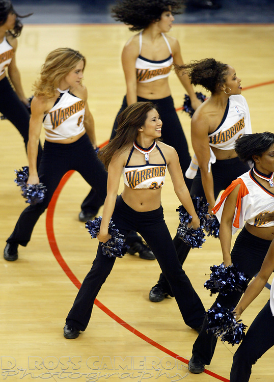 Warriors Girls cheerleaders entertain the crowd during a timeout in an NBA basketball game between the Memphis Grizzlies and Golden State Warriors, Monday, Jan. 13, 2003 in Oakland, Calif. The Grizzlies won 110-108. (Photo by D. Ross Cameron)