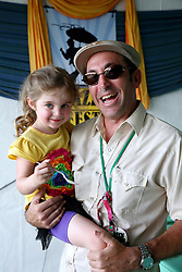 05 May 2012. New Orleans, Louisiana,  USA. .New Orleans Jazz and Heritage Festival. .Matthew Goldman and his beautiful daughter..Photo; Charlie Varley.