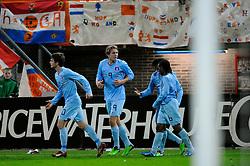 17-11-2009 VOETBAL: JONG ORANJE - JONG SPANJE: ROTTERDAM<br /> Nederland wint met 2-1 van Spanje / Erik Falkenburg (10) scoort de 1-0 en viert dit met Luuk de Jong en Vurnon Anita<br /> ©2009-WWW.FOTOHOOGENDOORN.NL