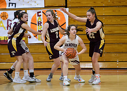 Hanover sophomore Caroline Adams looks for a teammate to pass to in the NHIAA Division II semi-final game at Pinterton Academy in Derry on Wednesday, March 11, 2020.  (Alan MacRae/Valley News)