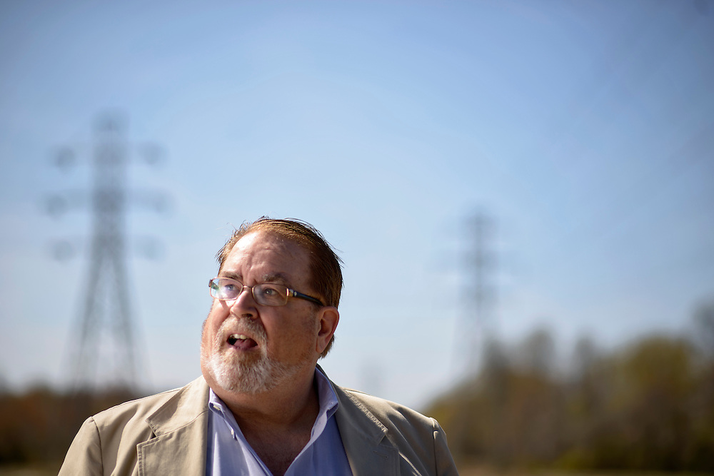 Woodstown New Jersey - April 21, 2014: John Hall of Woodstown, New Jersey, stands in front of electricity pylons in his town. Hall is a member of AARP New Jersey's Utilities Watchdogs and he has heard many complaints about cold calls by third-party energy suppliers trying to get customers to switch providers. There is a new law on the table, A3422, which aims to limit energy marketers and protect consumers.<br /> CREDIT: Matt Roth
