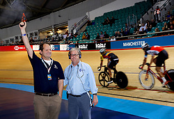A guest fires the starter's pistol for the Men's 7.5km Points Race during day one of the Six Day Series Manchester at the HSBC UK National Cycling Centre.