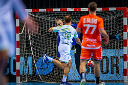 The Dutch handball player Bart Ravensbergen in action against Darko Cingesar from Slovenia during the European Championship qualifying match on January 6, 2020 in Topsportcentrum Almere