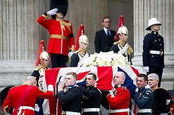 © London News Pictures.17/04/2013. London, UK.  Pallbearers carry the coffin of former British Prime minister Margaret Thatcher as it leaves St Paul's Cathedral in London following her funeral service on April 17, 2013. Photo credit : Ben Cawthra/LNP