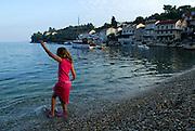 Female child (5 years old) wading in water, Racisce, island of Korcula, Croatia