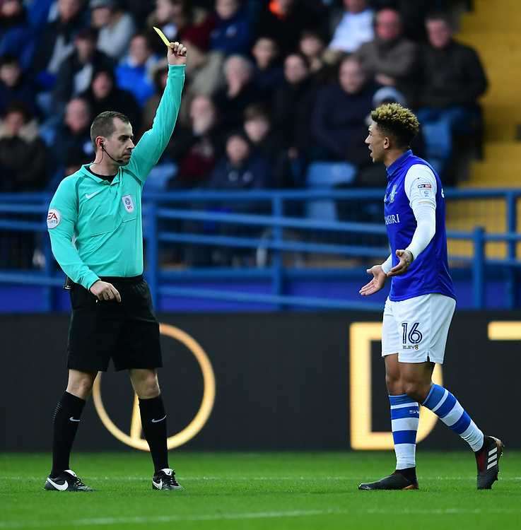 Sheffield Wednesday's Liam Palmer is shown a yellow card by referee Peter Bankes<br /> <br /> Photographer Chris Vaughan/CameraSport<br /> <br /> The EFL Sky Bet Championship - Sheffield Wednesday v Middlesbrough - Saturday 23rd December 2017 - Hillsborough - Sheffield<br /> <br /> World Copyright © 2017 CameraSport. All rights reserved. 43 Linden Ave. Countesthorpe. Leicester. England. LE8 5PG - Tel: +44 (0) 116 277 4147 - admin@camerasport.com - www.camerasport.com