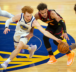 Mar 26, 2021; San Francisco, California, USA; Golden State Warriors guard Nico Mannion (2) steals the ball from Atlanta Hawks guard Trae Young (11) during the third quarter of an NBA basketball game at Chase Center. Mandatory Credit: D. Ross Cameron-USA TODAY Sports